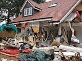 disgruntled builder smashes down row of new-build cottages