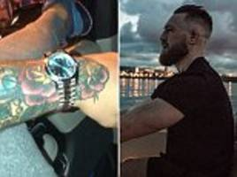conor mcgregor shows off £23,000 rolex during late night drive