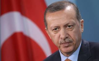 Turkish President Erdogan says collapse in lira a plot against the country