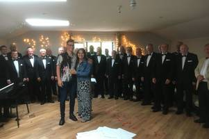 a man recreated a love actually scene with a male voice choir to propose