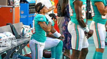 South Florida Police Asked Not to Buy Dolphins Tickets After Players Protest During Anthem