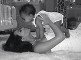 kim kardashian dotes on north as she gushes little girl will 'always be my baby' in throwback photo