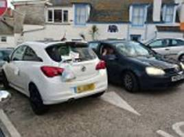 angry locals hit back at cheeky driver who left their car in an awkward spot