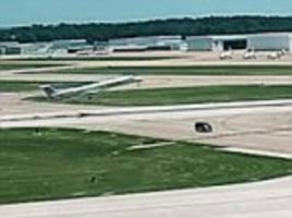 the terrifying moment an airport employee drives van across runway seconds before a plane takes off