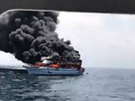 Whale-watching boat filled with tourists bursts into flames minutes after leaving a port in Taiwan