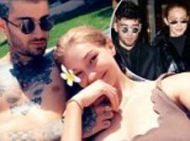 gigi hadid cuddles up to zayn malik in loved up snap as their vacation comes to a close