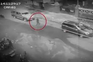 can you see it? residents baffled after chilling cctv shows 'ghost' walking through traffic in philippines