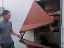 man makes very unusual door that folds when it opens