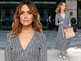 rose byrne looks stunning in a black and white patterned summer dress as she leaves new york hotel