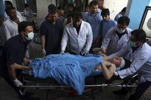 dozens killed in latest taliban attack on afghan army base, suicide bombing in kabul