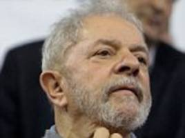 Brazil's disgraced former leader Lula registers as  presidential candidate from jail as 10,000 march