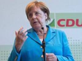 far-right protesters shout 'get lost' as angela merkel visited dresden in germany today