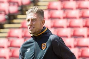 angus macdonald insists hull city have the depth to cope with championship fight