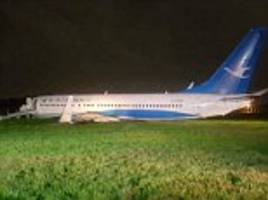 chinese plane with 157 passengers on board slides off the runway in manila