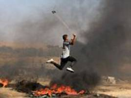 palestinians use slingshots to hurl stones at israel troops who return fire killing two