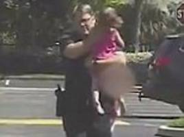 video shows moment cop rescues girl left in hot car