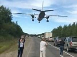 Warplanes thunder over stunned motorists after Russian Air Force turns motorway into runway