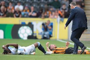 hull city's stephen kingsley forced off after clash of heads with blackburn's kasey palmer