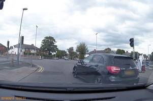 moment blatant mercedes jumps red light missing bmw by seconds