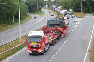 m25 and a13 traffic: pictures and video show huge transformer making its way to the dartford crossing