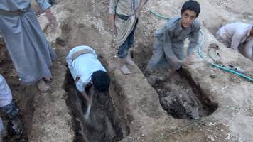 yemen war: boys dig friends' graves after air strike