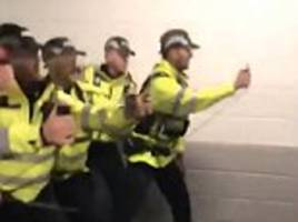 Police are forced to apologise after video shows officers pepper spraying Stoke City fans