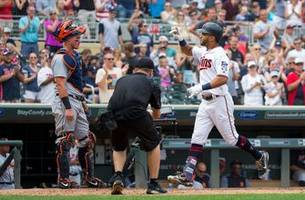 rosario's 8th inning home run lifts twins past tigers
