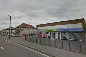 masked axe-wielding robber threatens co-op staff before making off with cash