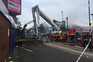 more than 60 firefighters tackle raging fire in aston as building collapses on road