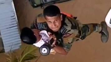 kerala floods: children winched to safety as rescue efforts step up