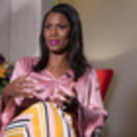 omarosa claims donald trump is holding wife melania hostage