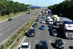 man spotted on m1 gantry near loughborough is arrested by leicestershire police