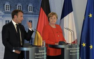 merkel objects to france's vision of a eu finance minister