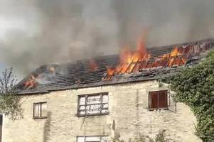 watch and listen as fire tears through this building and sends tiles crashing down into canal