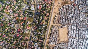 aerial photos reveal the stark divide between rich and poor