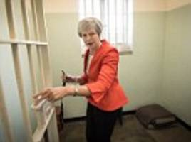 may is shown the robben island cell where mandela was held captive