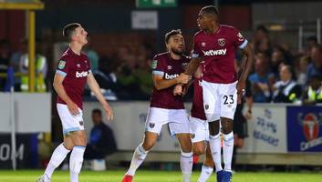 carabao cup roundup: west ham survive wimbledon scare as berahino finally scores for stoke