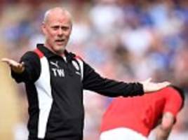 barnsley football club's former assistant manager charged with bribery offences