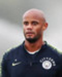 man city news: vincent kompany urges sky blues to kick united while they're down