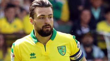 russell martin: norwich city defender leaves club after nine years