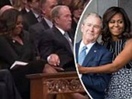 george w. bush playfully sneaks a piece of candy to michelle obama during mccain memorial service