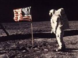 buzz aldrin blasts first man for not showing the planting of us flag