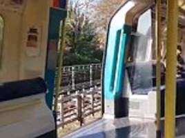 shocking moment london tube train hurtles along track while doors are wide open