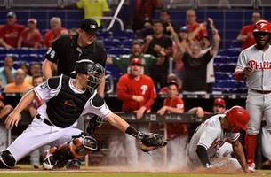 j.t. realmuto's two homers set marlins record, fall to phillies 9-4