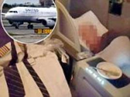 united airlines pilot changes out of uniform and takes nap in first class
