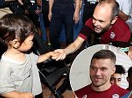 andres iniesta and lukas podolski collect donations after hokkaido earthquake