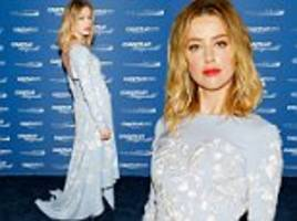 amber heard makes a fashion statement in floral printed blue dress at charity day on 9/11 in nyc