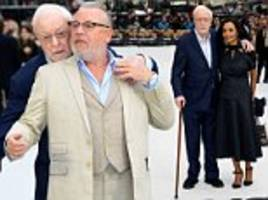 sir michael caine wraps an arm around co-star ray winstone at king of thieves premiere