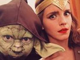 emma watson channels her inner wonder woman as she poses with yoda