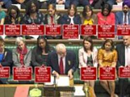 jeremy corbyn surrounded by diverse mps at pmqs in parliament